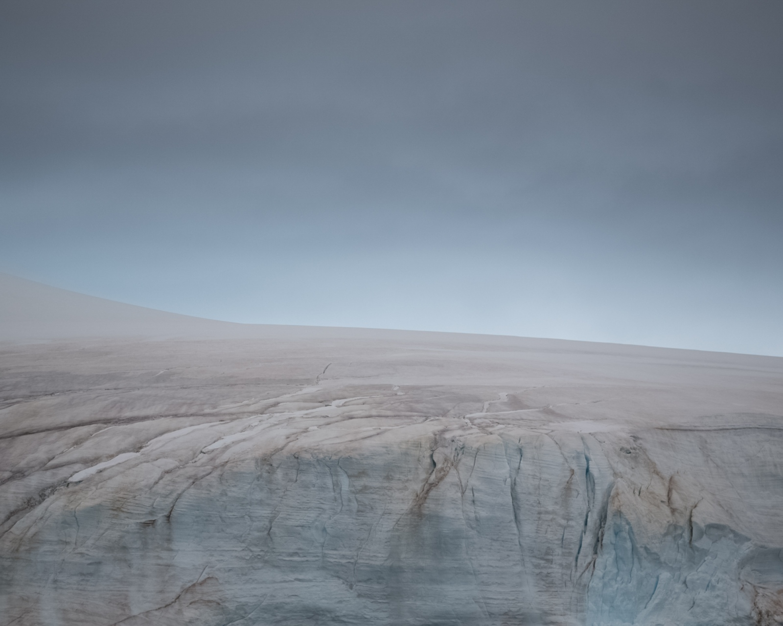In February, snow algae paints the glaciated surface of Danco Island, Antarctica.