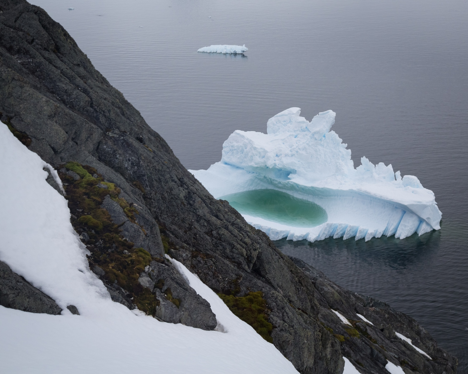A melt pool forms in an iceberg in Paradise Harbour, Antarctica.