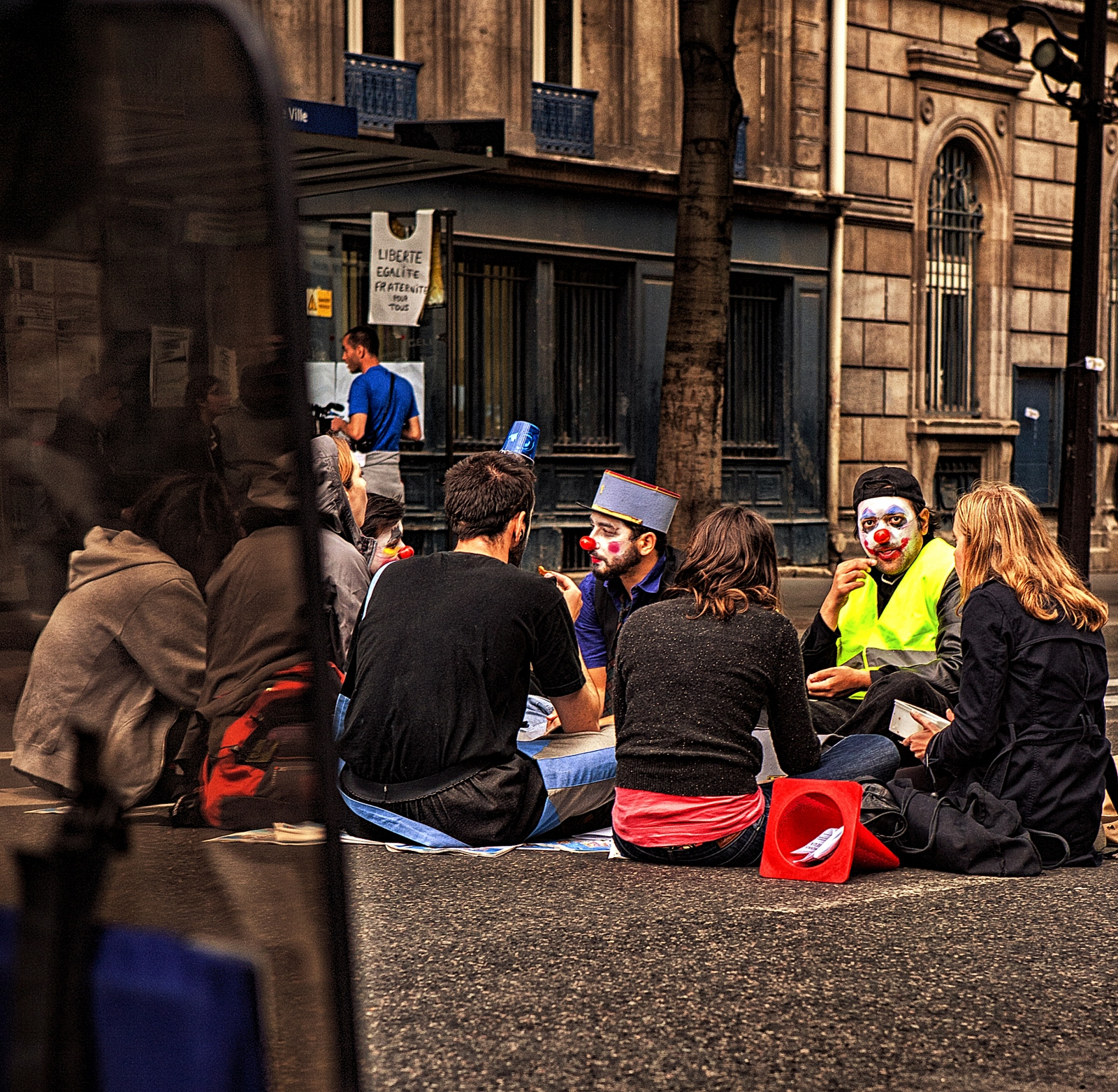 A bevy of clowns in a sit down protest in Paris.