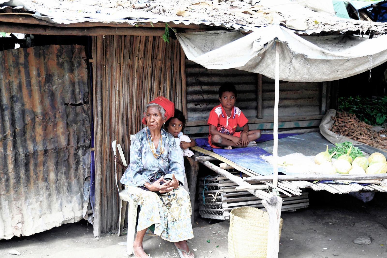 A grandmother looking after grand children a an...