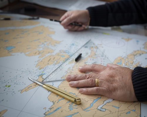 A navigation officer charts a course through the Fury and Hecla straight, a notoriously narrow and ice-choked passage along the west of Baffin Island. Nunavut, 2016.