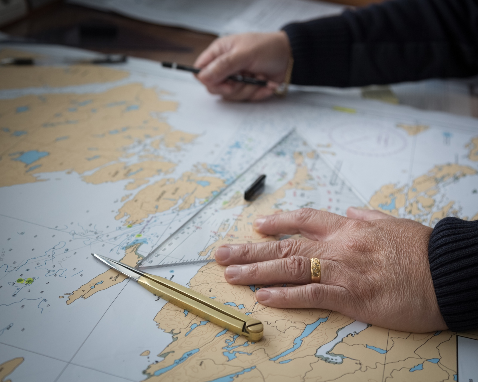A navigation officer charts a course through the Fury and Hecla straight, a notoriously narrow and ice-choked passage along the west of Baffin Island.Nunavut, 2016.