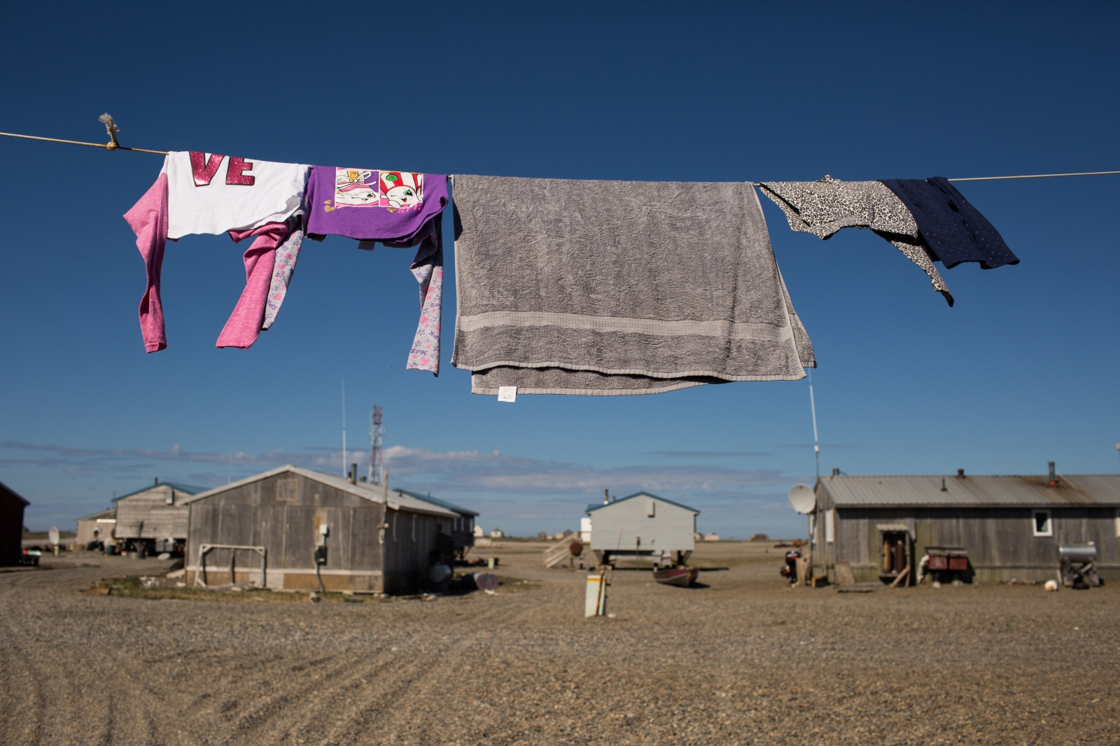 A clothesline hangs between homes in Gambell, Alaska.