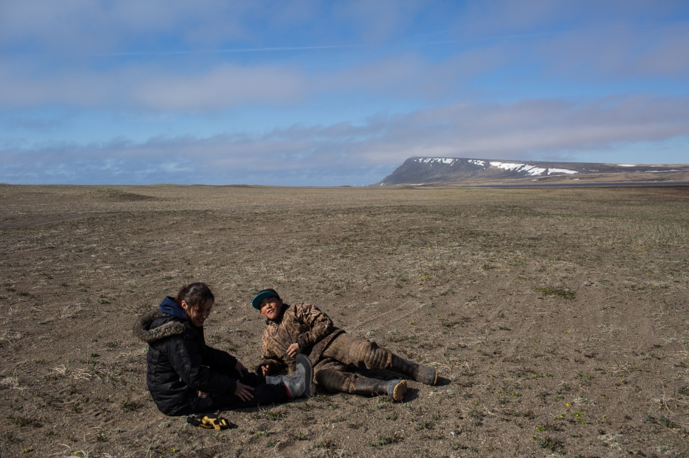 After a day with no seal sitings, Danielle and Chris Apassingok decide to head out to hunt pintails. On the way, they stop for a snack, a plant that in Yupik is called angukaq.
