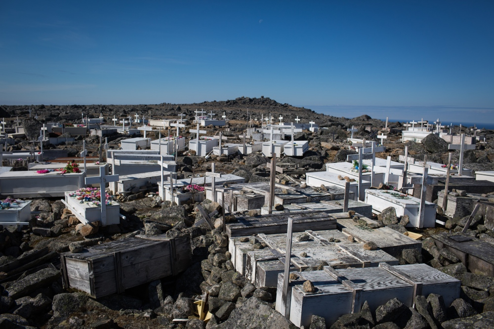 The cemetary on top of Sivuqaq Mountain in Gambell, Alaska. The deceased have been placed in reinforced coffins but are not buried.