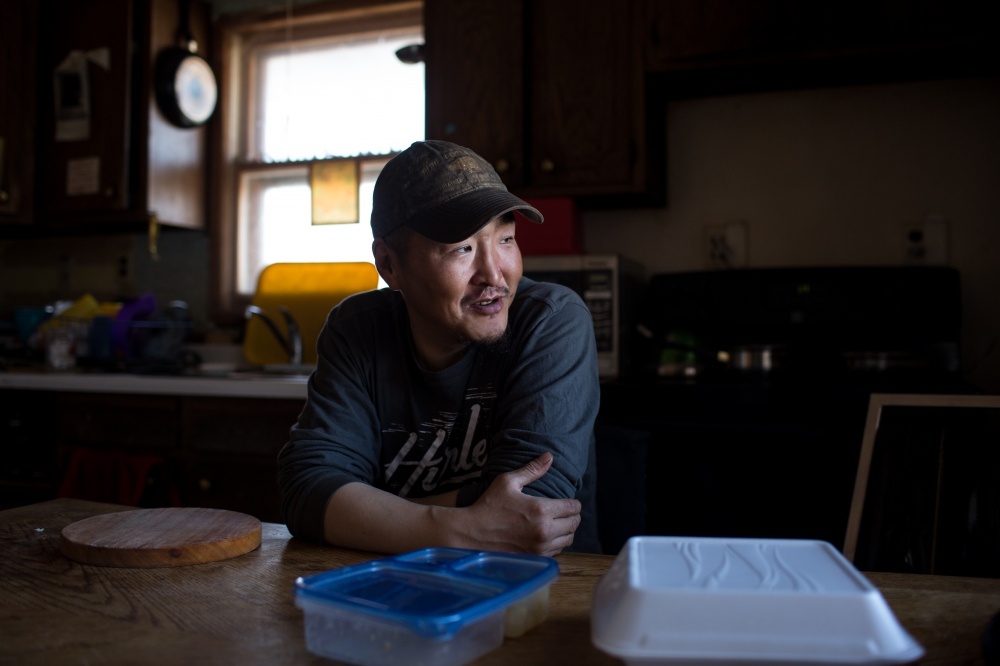 Daniel Apassingok takes his lunch break at his father's home in Gambell, Alaska.