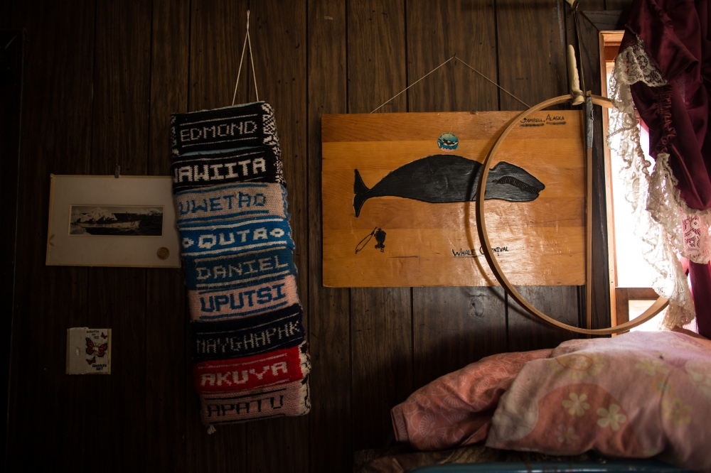 A wall in Daniel Apassingok's father's home in Gambell, Alaska.