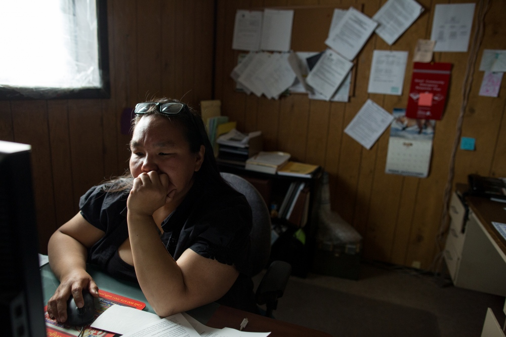 Susan Aakapak Apassingok, Chris's mother, in her offce in Gambell, Alaska. Susan works as the Vice Mayor of the village.