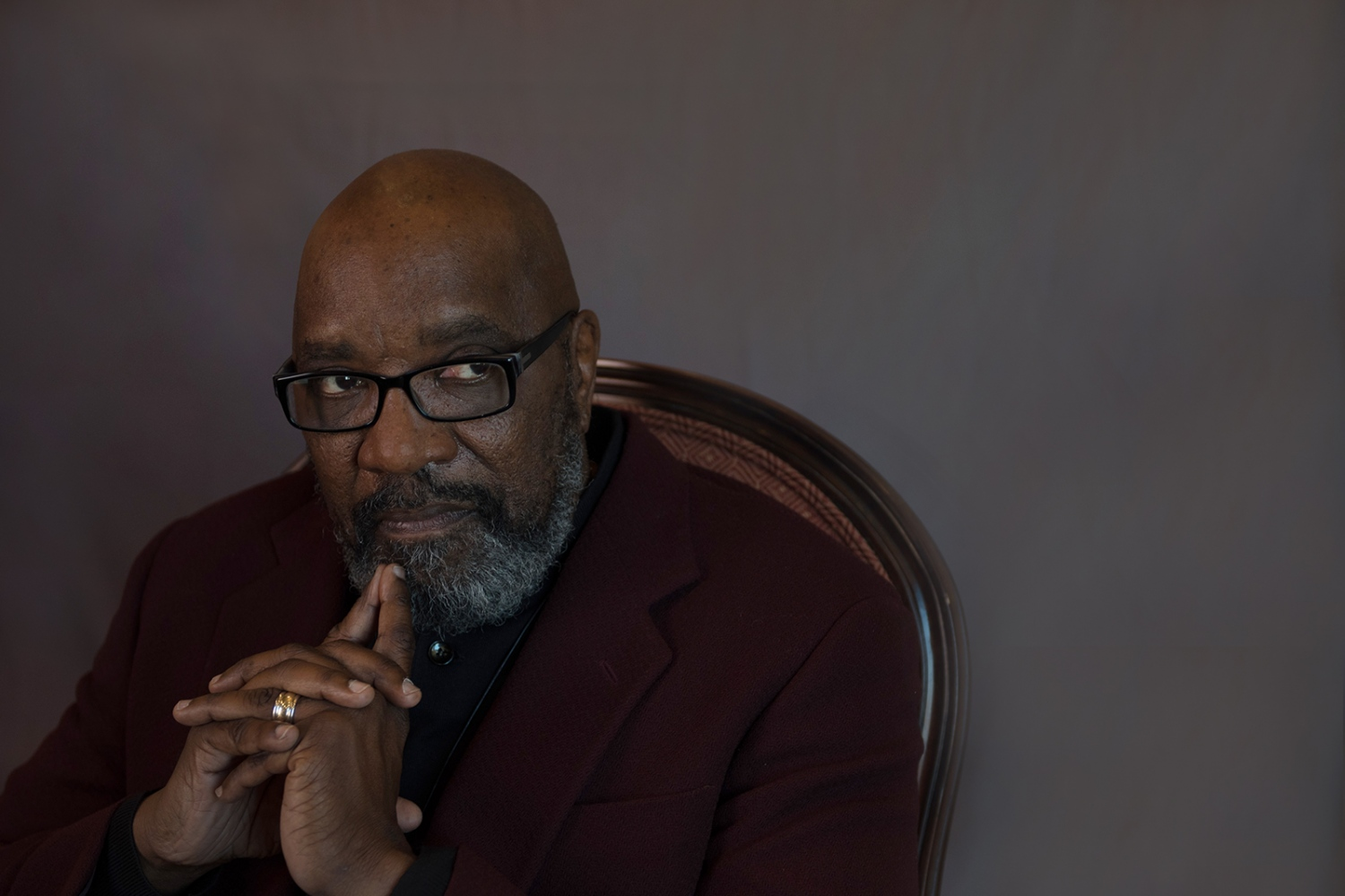 "Clyde Ruffin, 65, professor and chair emeritus (University  of Missouri,) senior pastor at Second Baptist Church, First Ward representative (Columbia City Council,) president of the John William Boone Heritage Foundation, Columbia, MO (originally from Kansas City, MO.) Marginalization I came of age in the late sixties, which was an extraordinary time of transformation for Black people. As a high school student I embodied the ivy league image of those who marched, boycotted and sat at lunch counters in their quest for Civil Rights equality. Always dressed in slacks, starched shirts, matching sweaters and shoes that were shined to perfection I endeavored to prove to a world that refused to see me that I was worthy, honest, intelligent and capable. In 1968 Martin Luther King was assassinated and the illusive dream of being judged by the ""content of my character"" rather than the ""color of my skin"" died with him. I discarded my buttoned down image for a dashiki, black leather jacket and boots. I stopped singing ""We Shall Overcome"" and started screaming ""Say it loud, 'I'm Black and I'm Proud!'"" No longer an exceptional Negro knocking on the door of injustice hoping that someone would hear me, I became an angry young Black man, fully prepared to kick the door in and take my rights ""by any means necessary."" As a college student, I became a proponent of the Black Arts Movement, which began to shape my identity as a socially conscious performing artist dedicated to the education and empowerment of Black people. I was always conscious of my Blackness, striving everyday to be ""blacker"" than I was the day before. I did not realize that my hyper race consciousness was not only fueled by anger at a world that I believed would always reject me but it also forced me to constantly justify my existence, validate my identity and forge my way through the dark maze of marginalization. Not unlike many Black people, I was able to work, establish a family and achieve a level of success in spite of carrying this burden of Blackness, never anticipating that after twenty years I would reach the tipping point. In 1988 I was blessed to visit five African countries. As I disembarked in Ghana, I was shocked to see that the path to the terminal was lined with armed soldiers. As I passed through, one of them quietly said, ""Welcome home brother."" When I turned to respond he looked blankly into the distance and I knew that his words of acceptance were a forbidden act that my presence compelled him to break. In Egypt I recall walking down at street in Cairo, hearing someone screaming ""My brother!"" I turned to see a large man who walked with a cane, coming quickly towards me. I stopped as he reached out to me and said, ""My brother, you have finally come back to me. "" Then he looked deeply inside me and walked away. In Ethiopia I was stopped by someone who refused to believe that I was not native born because there was something uniquely Ethiopian about my eyes. I experienced similar gestures of welcome and recognition in Kenya and I knew that something within me was being transformed. Finally, I stood in the dungeon of a slave holding fort in Senegal, looking at the Atlantic Ocean through the narrow opening of the ""door of no return."" As I listened to stories of families destroyed, abused men and women who were beaten, shackled and branded before being loaded in the hull of slave ships. I could feel the presence of ancient generations whose indomitable spirits were not conquered by the horrors of history and it released a deeper sense of my own power. For the first time in my life, I began to feel the burden of Blackness lift and I knew that I was finally being set free from seeing myself through the lens of those who wanted to marginalize me. From that moment until know, I move through the world as someone who owns the time and space that I occupy. I live without apologies or explanations for who I am as a creative, politically engaged Black man of faith—a son, husband, father and teacher."