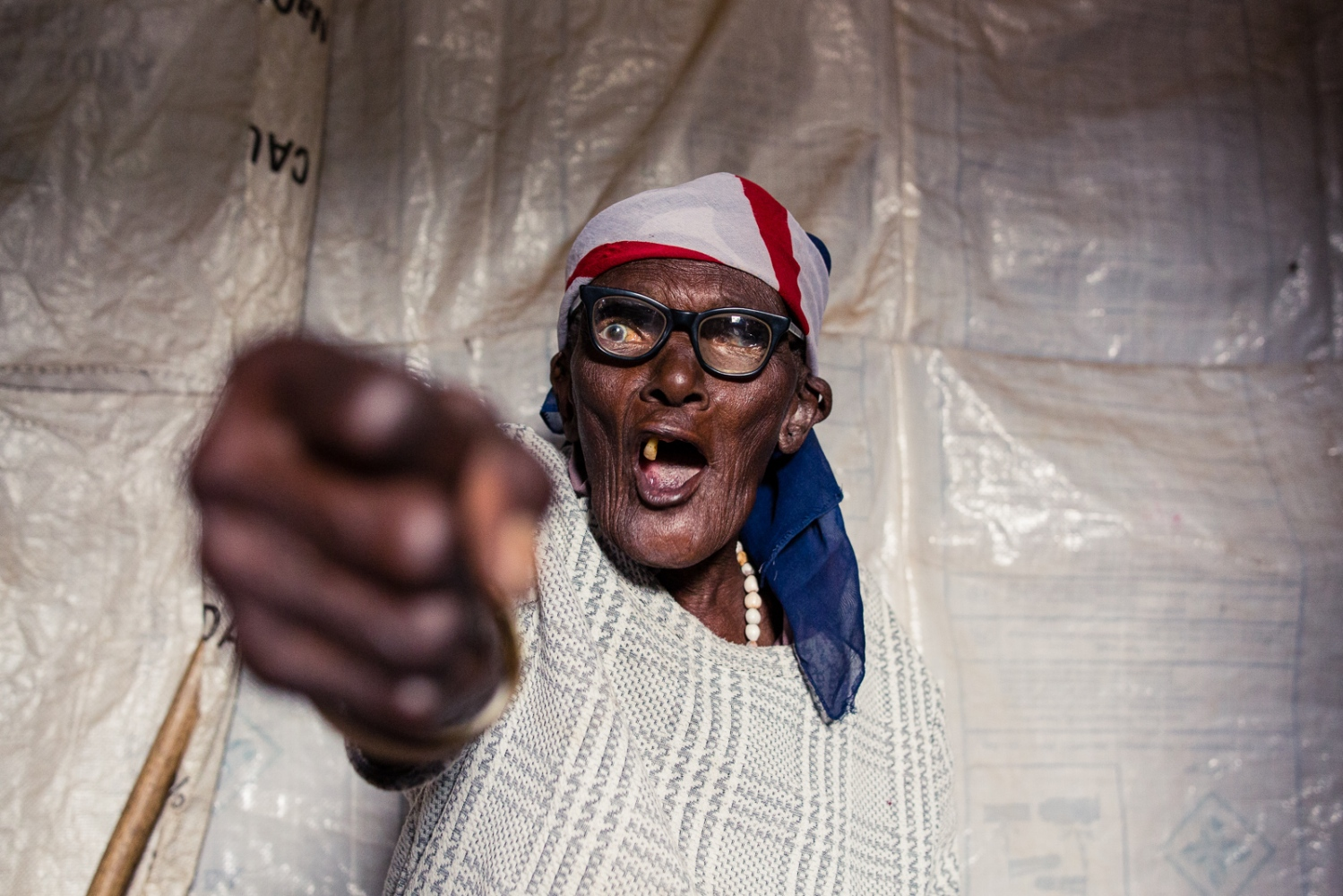 Nairobi, KENYA, February 28, 2017: Helen Wairimu, 106, is the oldest participant of the 'Shosho Jikinge' group in the Korogocho township. A rape survivor, Helen has been training self-defense techniques with around 20 other ladies, aged between 55-106 years, for six years. In 2016, a heavy-set, young man came to Helen's hut and raped her. Helen still participates in the class every week, eager to encourage the other women to train harder through her role as a survivor.