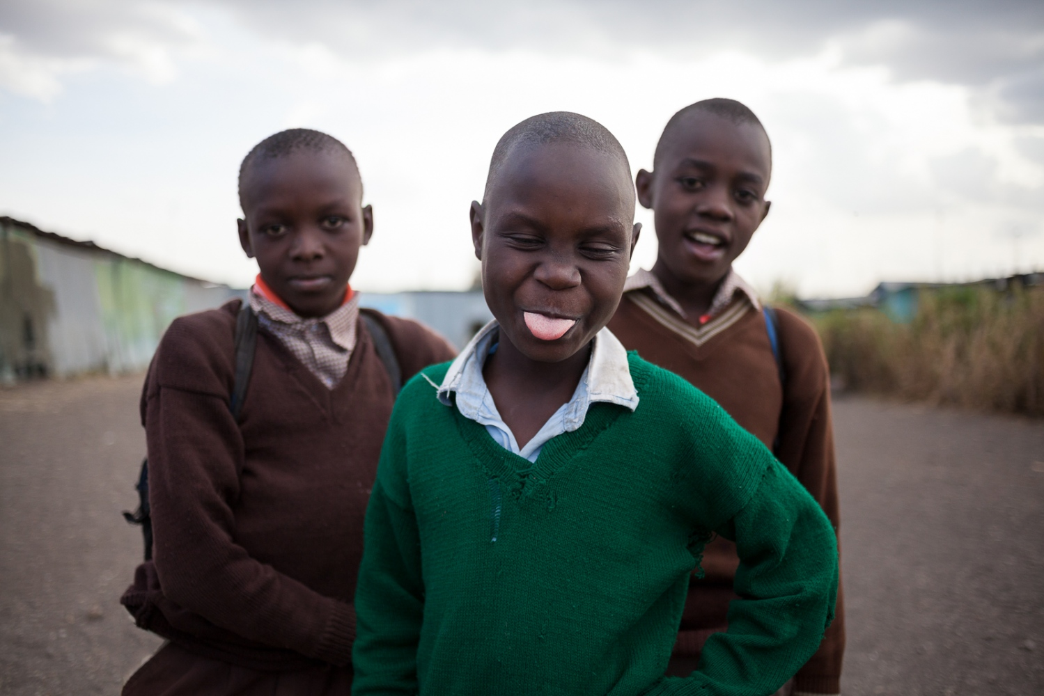 Nairobi, KENYA, October, 2013: School children play during a break at Jobenpha Community school. Some of the ex pupils made it to university, showing the kids that there is a way out of the slums through education.