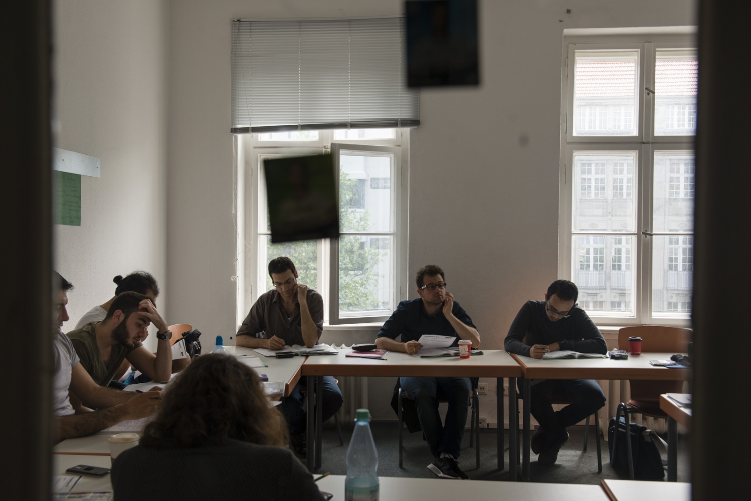 BERLIN | GERMANY | 2016-05-31| Refugees, many of whom Syrians, study German inside a language school located in central Berlin.