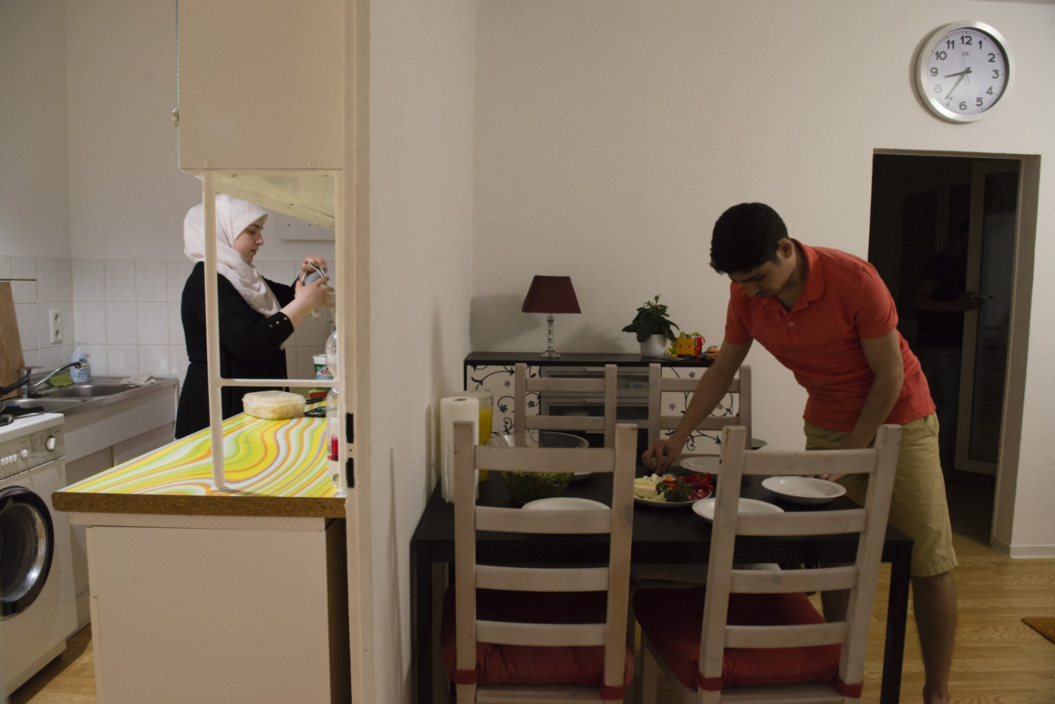 BERLIN  |  GERMANY | 2017-04-02 | Maher (24) and Amani (32) prepare dinner together in their new home in Lichtenberg, Berlin. The couple, both from Damascus and IT students, had to quit school and flee Syria due to the ongoing war there. The couple arrived in Germany in July 2015 and have settled down and started a new family with giving birth to Baby Kareem who is not 4 months old at this time.BERLIN, GERMANY | 2017-04-02 | Maher (24) and Amani (32) prepare dinner together in their new home in Lichtenberg, Berlin. The couple, both from Damascus and IT students, had to quit school and flee Syria due to the ongoing war there. The couple arrived in Germany in July 2015 and have settled down and started a new family with giving birth to Baby Kareem who is not 4 months old at this time.