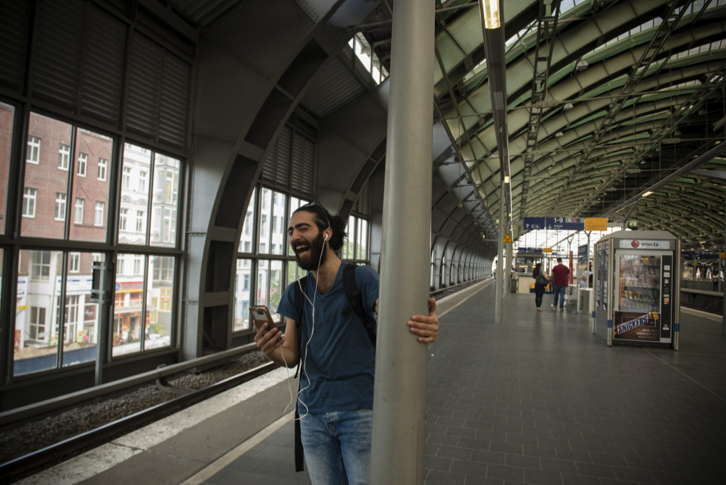 BERLIN  | GERMANY | 2016-06-10  | Fadi (22) video chat with her fiancé who is still back in Syria while waiting for the train to arrive. Many refugees had no choice but leaving their loved ones behind and be the first to arrive in europe, in hope finding jobs and being able to support their families back in Syria.
