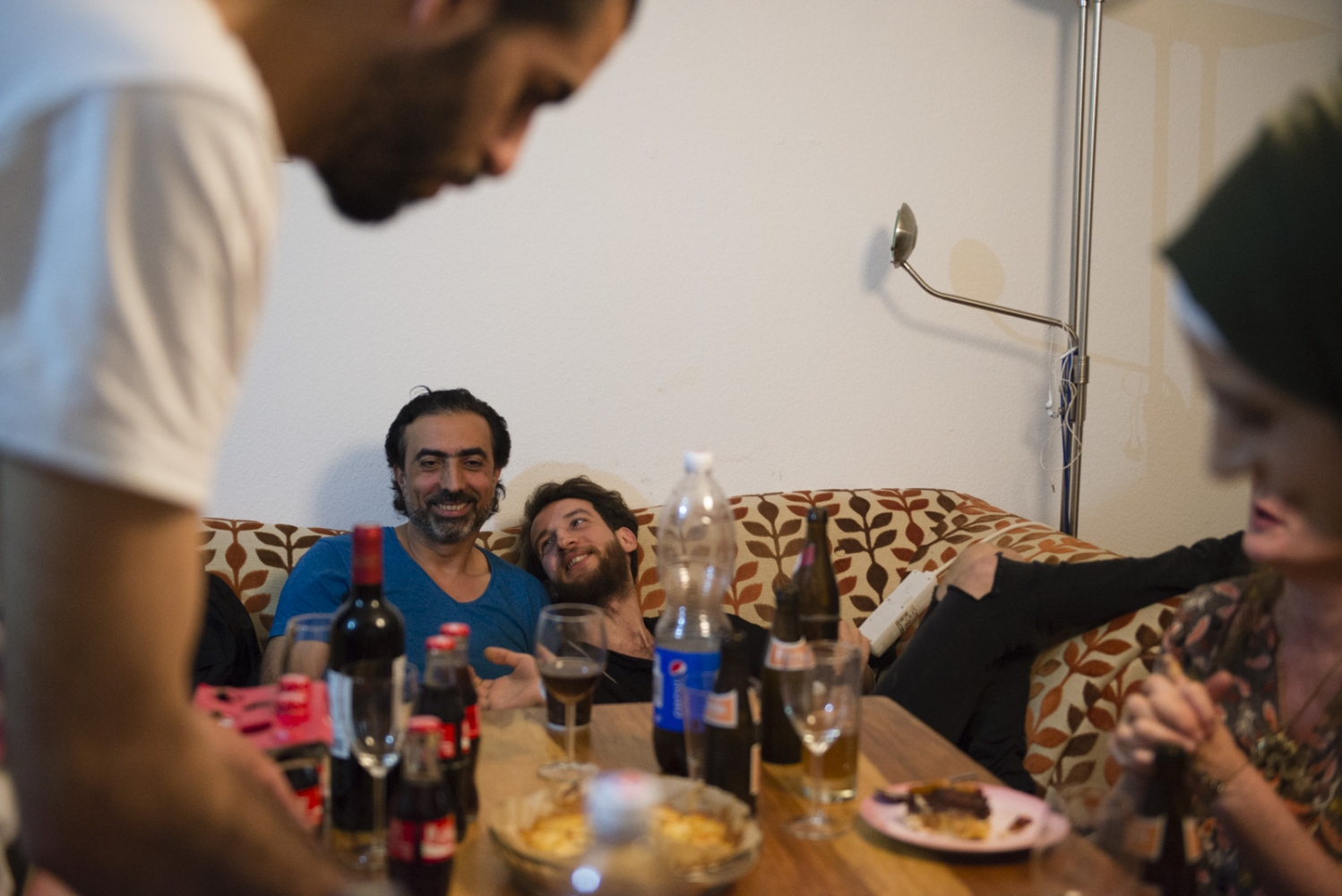 BERLIN| GERMANY | 2016-06-10|Syrian and German friends have come together to celebrate Alaa's 26th birthday at his house over food and homemade cake.
