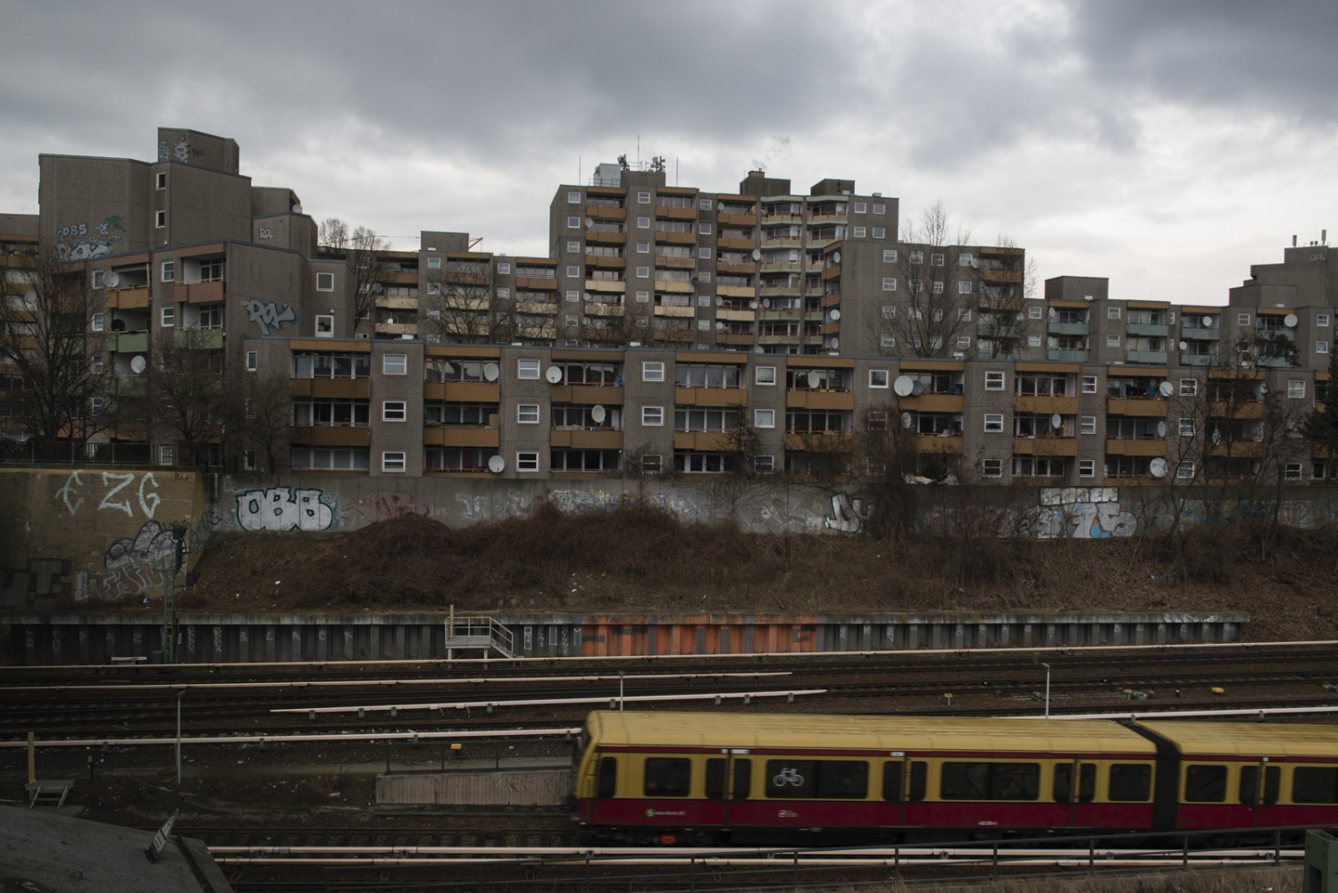 BERLIN | GERMANY | 2017-03-06 | An overview of a large housing complex by the railway. With the housing crisis that is going on in Berlin and across Germany, finding an apartment or a room to rent has become a nearly impossible task, for locals as well as refugees.