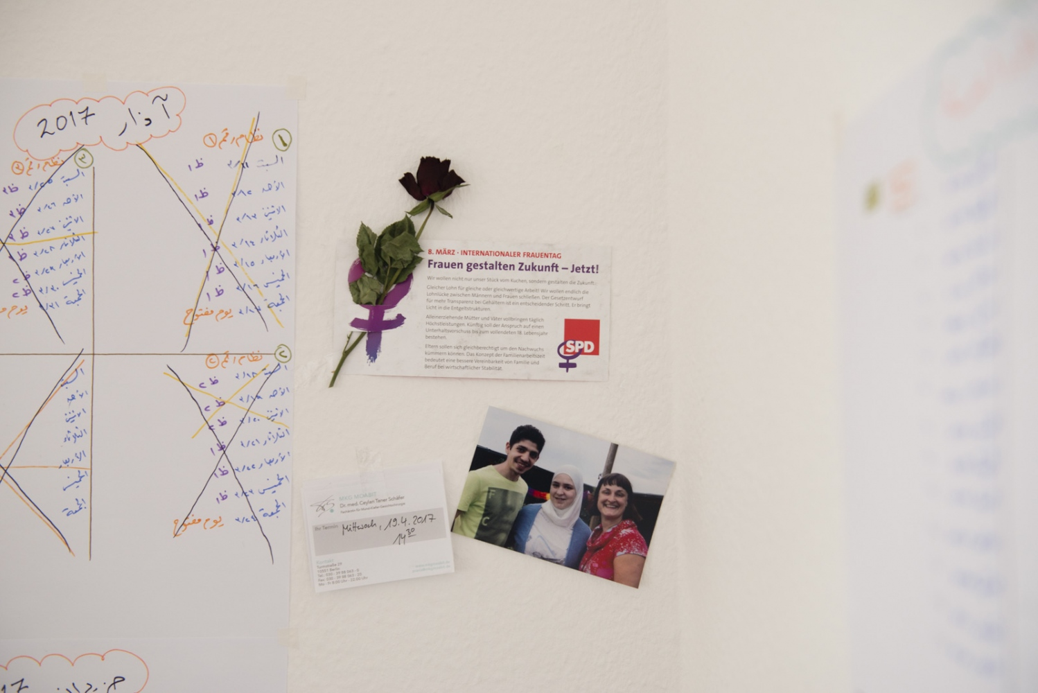 BERLIN| GERMANY | 2017-04-11 | Notes, photos and a studying calendar on the wall of Amani and Maher's study room. Amani (32) had to flee Damascus alongside his best friend at the time, Maher (24), to leave a troubled past behind in Damascus. Maher propose to Amani despite the unusual age gap and her previous marriage and the couple got married in Istanbul. Upon arriving in Germany, Amani restored a new life and gave birth to Kareem in Nov 2016. The couple are now settled in Lichtenberg, Berlin.