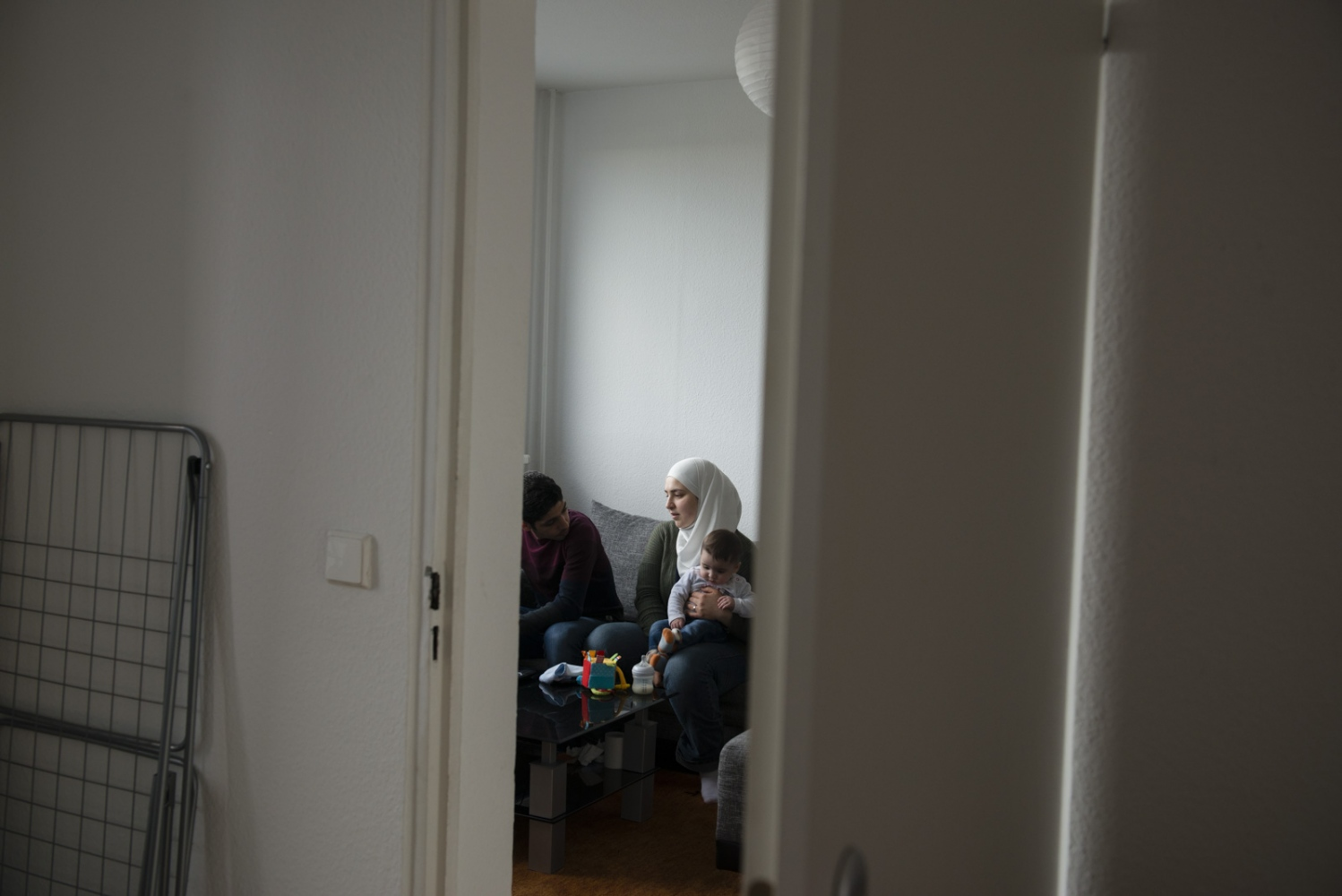 BERLIN | GERMANY | 2017-04-11 | In an unusual setting of syrian marriage, Amani Kaskin (32) and Maher (24) share that house chores and caring for 4 month old baby Kareem. Amani had to flee Damascus alongside his best friend at the time, Maher (24), to leave a troubled past behind in Damascus. Maher propose to Amani despite the unusual age gap and her previous marriage and the couple got married in Istanbul. Upon arriving in Germany, Amani restored a new life and gave birth to Kareem in Nov 2016. The couple are now settled in Lichtenberg, Berlin.