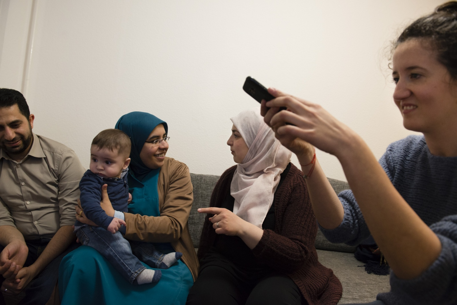 BERLIN| GERMANY | 2017-04-13 | On the third anniversary of their marriage, Maher (24) and Amani (32) host friends in their new home in Lichtenberg, Berlin. The couple, both from Damascus and IT students, had to quit school and flee Syria due to the ongoing war there. The couple arrived in Germany in July 2015 and have settled down and started a new family with giving birth to Baby Kareem who is not 4 months old at this time.