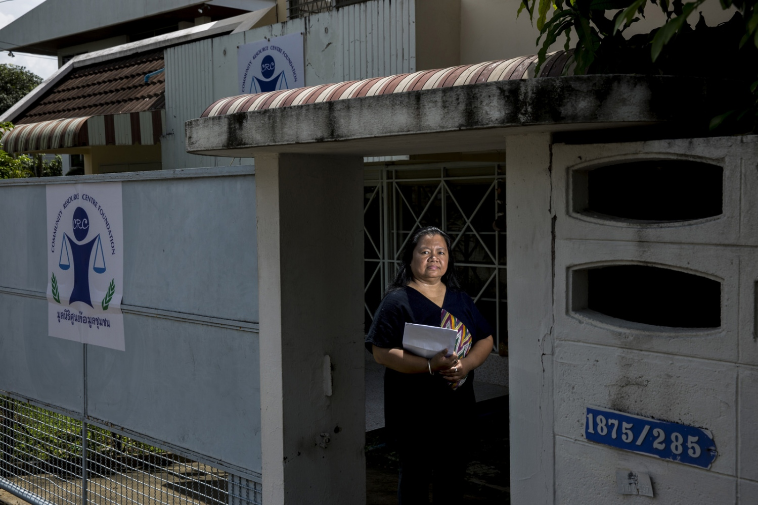 Lawyer Sor Rattanamanee Polkla in the doorway of the Community Resource Centre Foundation where she works. Her foundation assists communities around the country who face legal challenges often related to the environmental threats from companies. Bangkok, Thailand