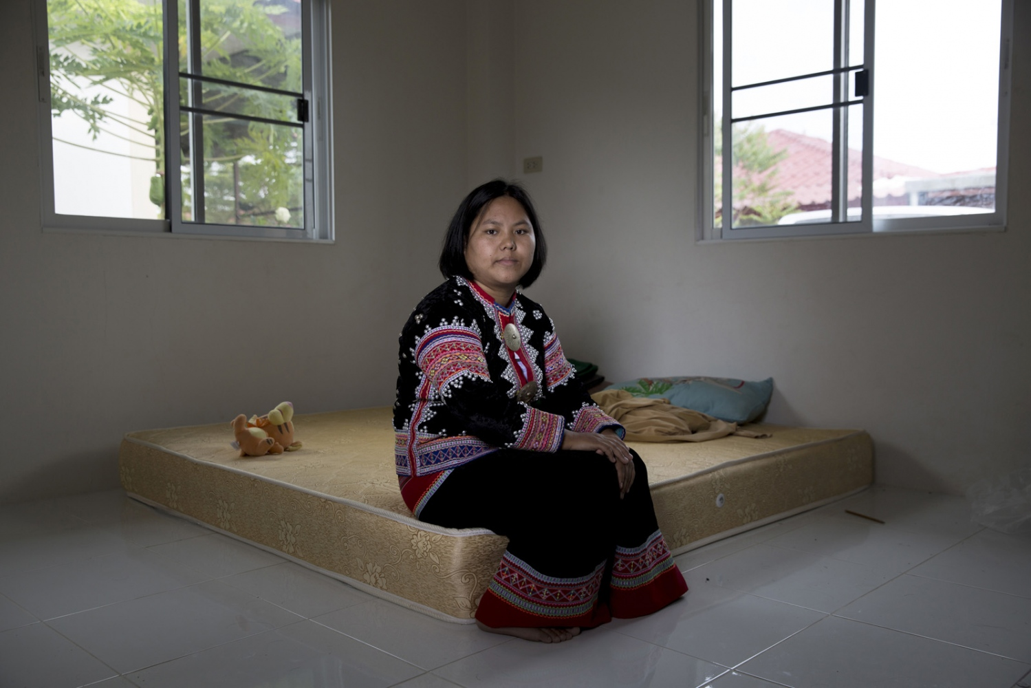 Yuphin Saja, a member of the Lahu minority group in the safe house she has been forced to move to with her husband and small children for their own protection after a member of the group was allegedly shot dead at a checkpoint. Northern Thailand