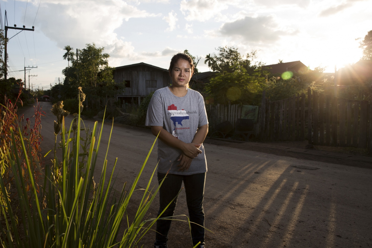Chutima Chuenhuajai, a member of the Rak Ban Heang environmental group, on the main street of the village of Ban Heng in Lampang Province where the threat of an open-pit coal mine looms. Lampang, Thailand