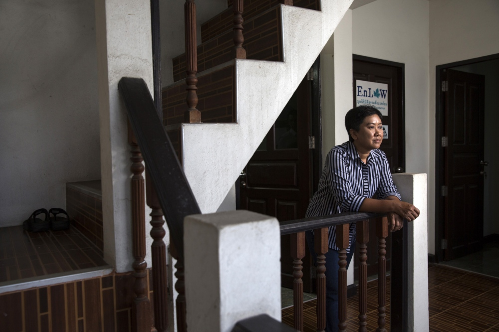 Supaporn Malailoy of the En-Law Foundation in the stairway of her office in the Ramkamhaeng area of Bangkok. She advises communities in Thailand how to use and participate in the legal system so they can defend their own rights, protect nearby natural resources and the environment of their community. Bangkok, Thailand