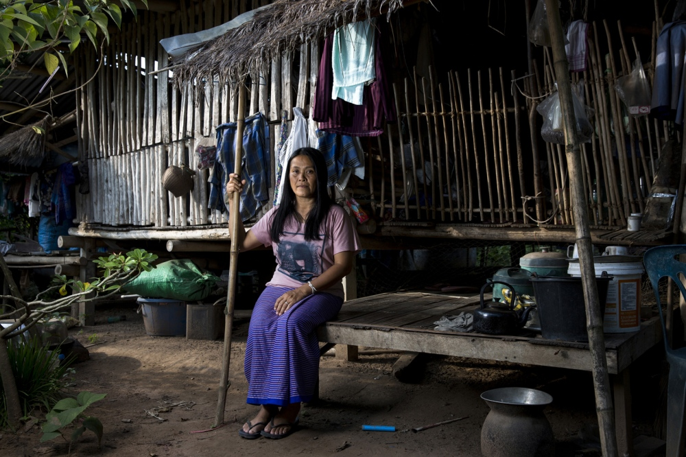 Oranuch Pholpinyo sits at a house in the village of Bo Kaew in Chaiyaphum Province. She is the Co-ordinator of the E-san Land Reform Network which assists people affected by issues concerning land and forest use, as well as industrial factories. Chaiyaphum, Thailand