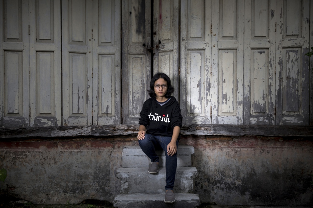 Ulairat Chooduang, a member of the Thai Volunteer Service sits in a small alleyway in Songkhla city. She is in the process of opening the first office of the Thai Volunteer Service located in Southern Thailand. Songklah, Thailand