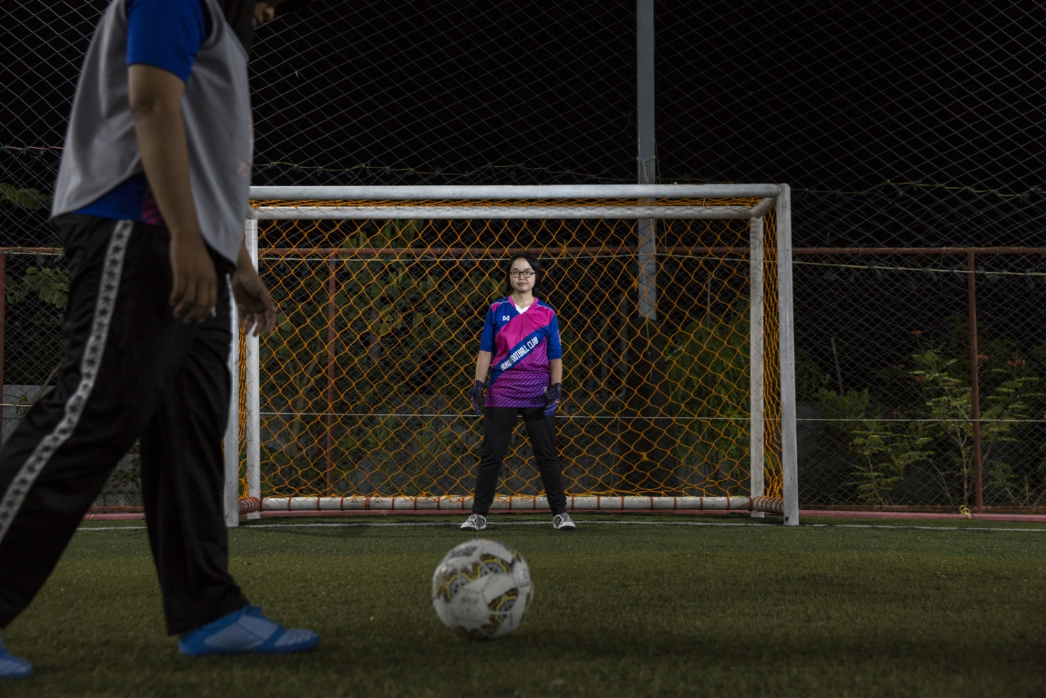 Anticha Sangchai, an openly bi-sexual professor at the Prince of Songklah University Pattani campus, stands in goal on the football pitch where her all-girls club Buku FC practice weekly. She also runs a small book-shop that has books related to gender issues, both of which are not easy in a conservative Muslim area of Southern Thailand that is still in conflict. Pattani, Thailand