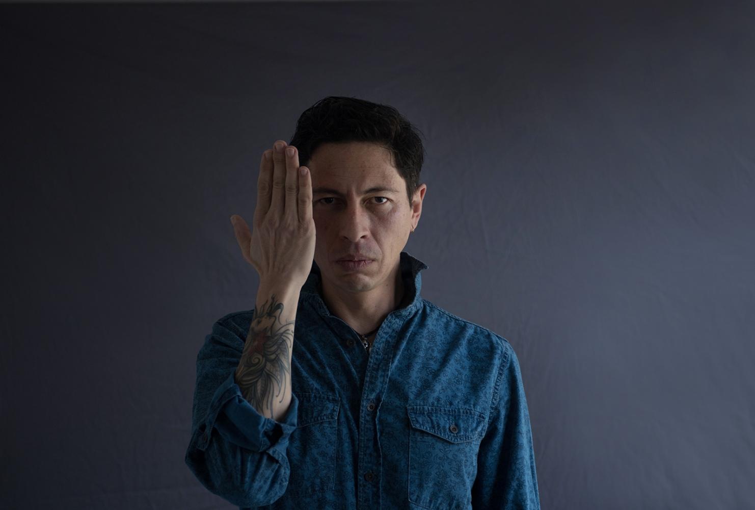 Ozzy Silva, 43, artist, Columbia, MO, originally from Bogota, Colombia. Ozzy Silva, 43, artista y artista de tatuage, Columbia, MO, originalmente de Bogotá, Colombia.
