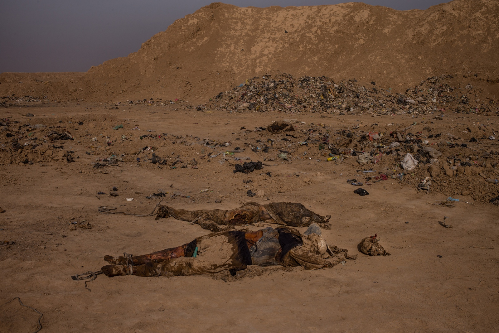 Two bodies lay in a garbage dump near the town of Hamam al Alil, which had been liberated from ISIS control two days earlier, as seen on November 9, 2016. The men appear to have been executed, with their arms and legs bound together and a cloth covering their eyes. They remained unidentified at the time the image was taken but were believed to have been former police officers, executed by ISIS as they retreated further in to Mosul. Some mass graves have been found as the Iraqi Army advances on the city, a chilling reminder of the brutalities ISIS inflicts.