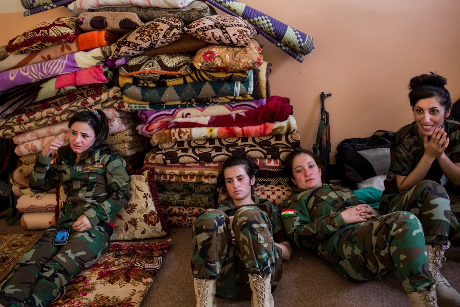 Soldiers with the Yazidi 'Sun Ladies' battalion relax during down time at their base near Sinjar, in Kurdistan, Iraq, on Tuesday, August 30, 2016.