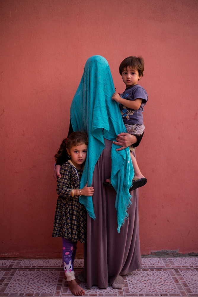 Suad, 29, poses for a photo with her two young children Farah (left) and Faraj (right), in Khanke, Iraqi Kurdistan, on Wednesday, August 31, 2016. Suad, whose name has been changed, was abducted with her two children in 2014 when ISIS overran her village. Until this day, she does not know the fate of her husband. She was held in captivity and forcibly married to an ISIS fighter who repeatedly raped her. Her son Faraj, 2, speaks only Arabic rather than Kurdish, as a result of being raised around Arabic speaking ISIS fighters. Suad and her two children managed to escape only after a highly complicated rescue plan was enacted.