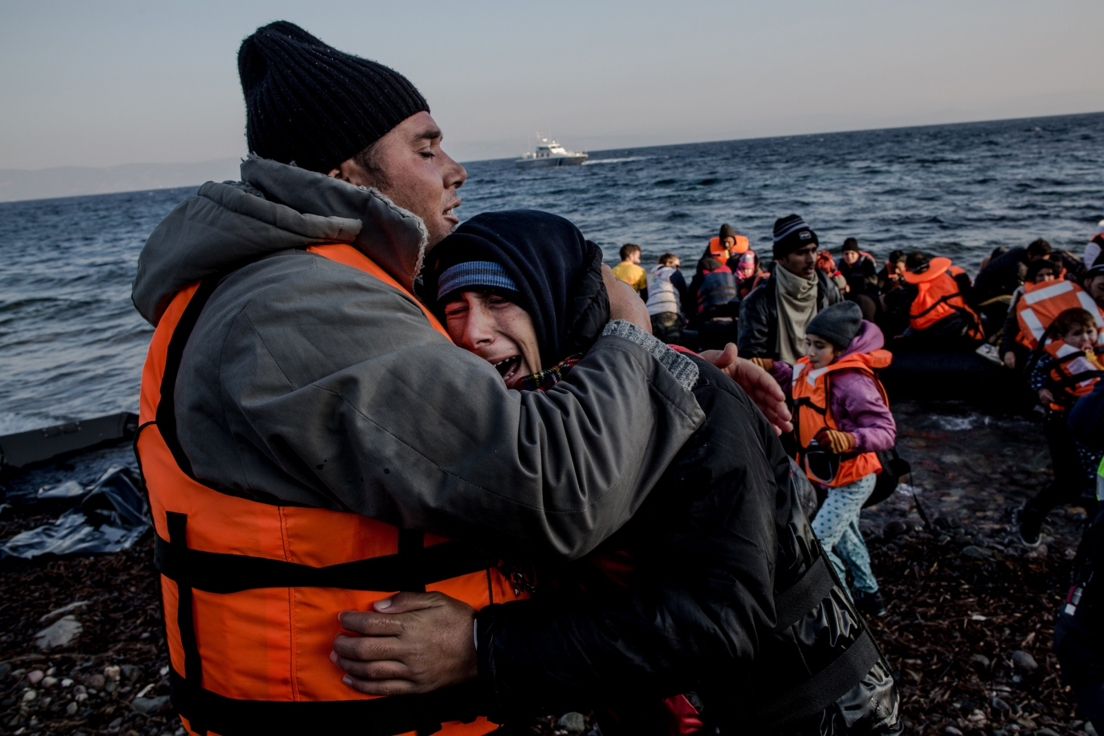 A man comforts his crying son shortly after arriving on the shores of Lesbos, Greece, on November 17, 2015. The roughly 1.5 hour boat ride between Turkey's western coastline and the closest Greek island has cost anywhere between $900-3000 per person. With winter approaching, the weather also becomes more unpredictable, causing further confusion and fear for refugees fleeing conflict.