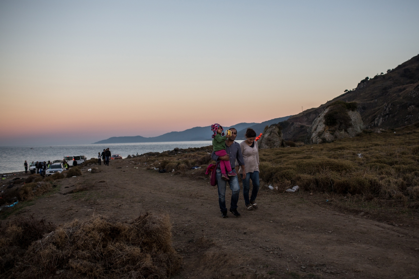 A refugee family, with nothing but the clothes on their backs, makes the several kilometers walk towards a transit center in Lesbos, Greece, on November 12, 2015, shortly after making the crossing from Turkey.