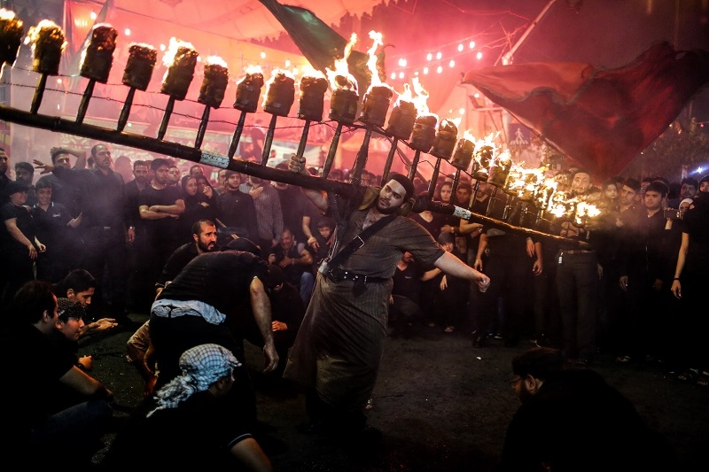 The Iraqis who live in Iran lighten up torches every year at Tasou'a and Ashoura nights and swing them as a way to mourn for Imam Hossein (AS). (Tehran)