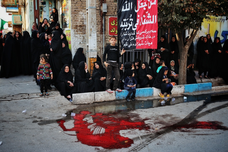 During the lunar month of Moharram, certain animals like cow and sheep are sacrificed and people cook food with their meat. People wait for watching the mourning groups on Ashoura Day after sacrificing the animals. ( kashan/noosh abad)