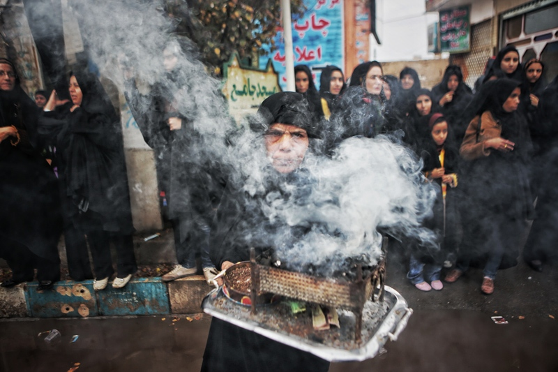 In the Iranian culture, burning Esfand (Peganum harmala) is a way to freshen up the air and prevent the evil eye and dispel sadness. A woman on Ashoura Day is burning Esfand in the streets that people are mourning in them. ( kashan/noosh abad