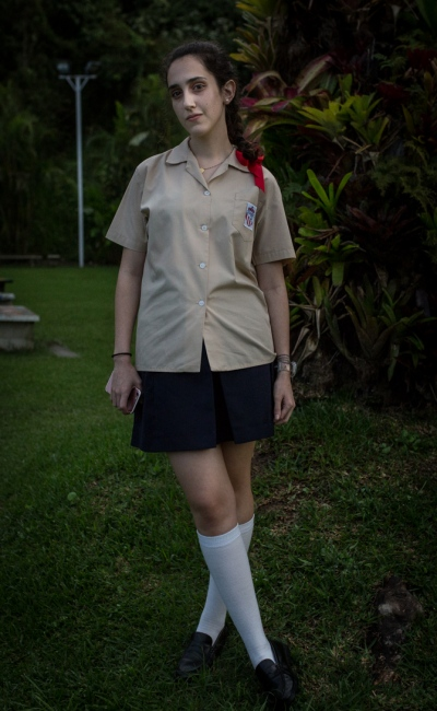 A Girl poses for a portrait wearing her school uniform. Colegio Merici, Cerro Verde, Caracas. November, 16th, 2017.