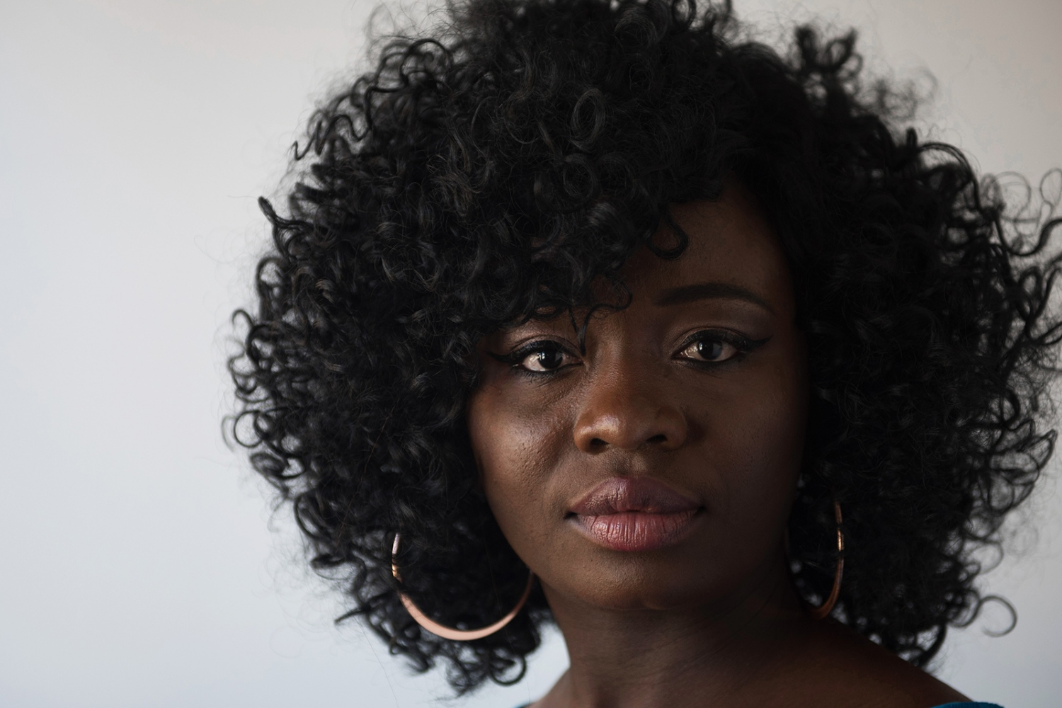 Nina Karma, 27, nursing home caregiver, Columbia, MO, originally from Togo.