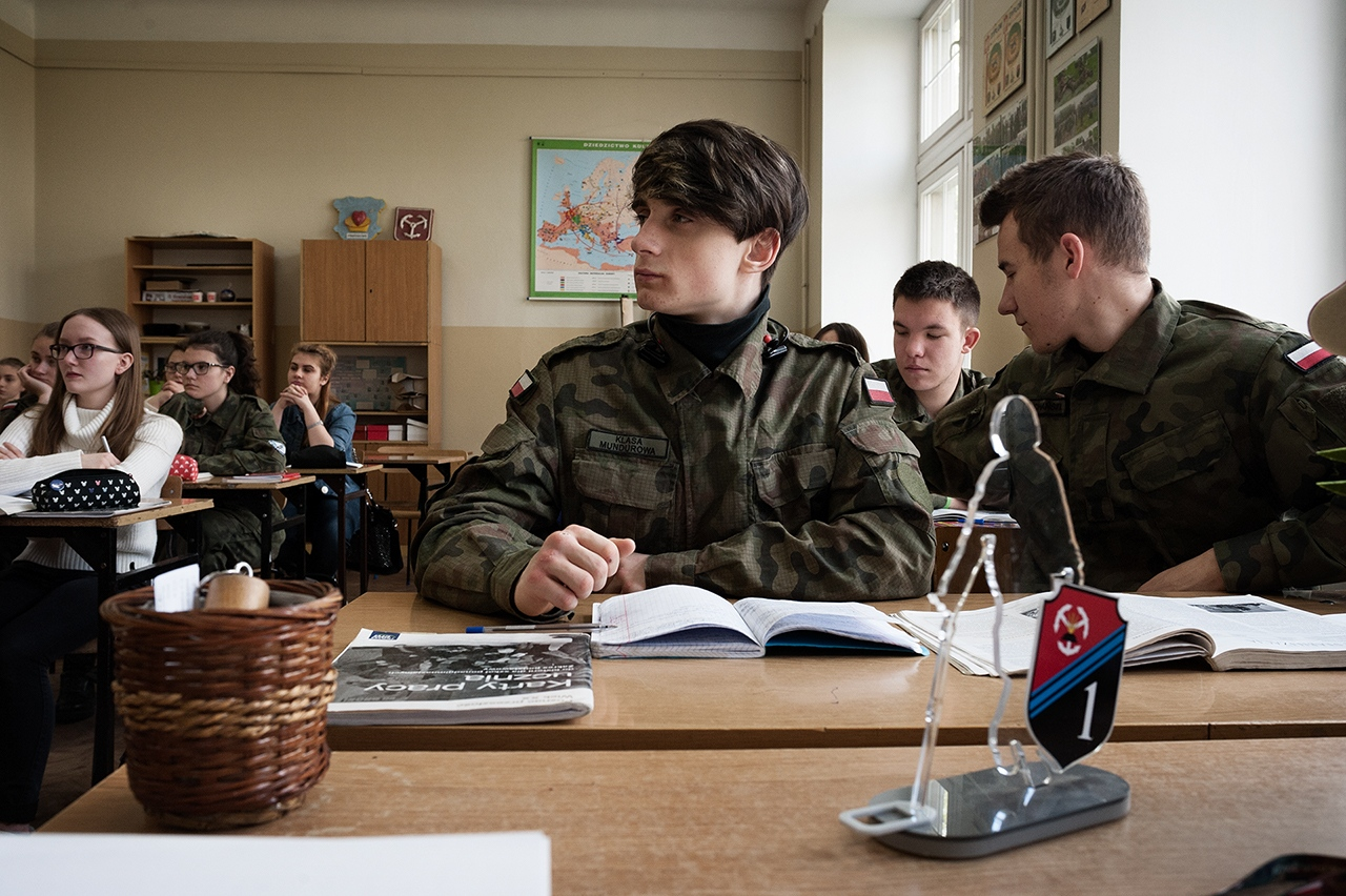 """The 16 years old students during the history class. The students who chose """"military profile"""" attendthe same classes as those from """"Humanist Profile"""", with the difference that twice a week theyhave to wear army uniforms."""
