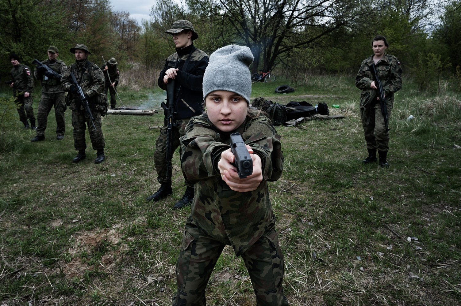"""One of the students (16 years old) during practical activities carried out by the paramilitaries in the public high school in Brzeg. Skarbimierz/Brzeg 2017 In Poland the first military classes were created in 1999, but only starting from 2014 the program began to arise greater interest among youth. The classes are aimed at teenagers between 16 and 19 years old, although some of the schools allow enrolling at the age of 13. The program considered as a """"pedagogical innovation"""" is developed within the framework of the subject Education for Security. As such it is not officially recognized by the Ministry of National education, but enjoys an increasing tutelage of the Polish Army; especially since the ultra-conservative Law and Justice Party came to power in Poland in October 2015."""