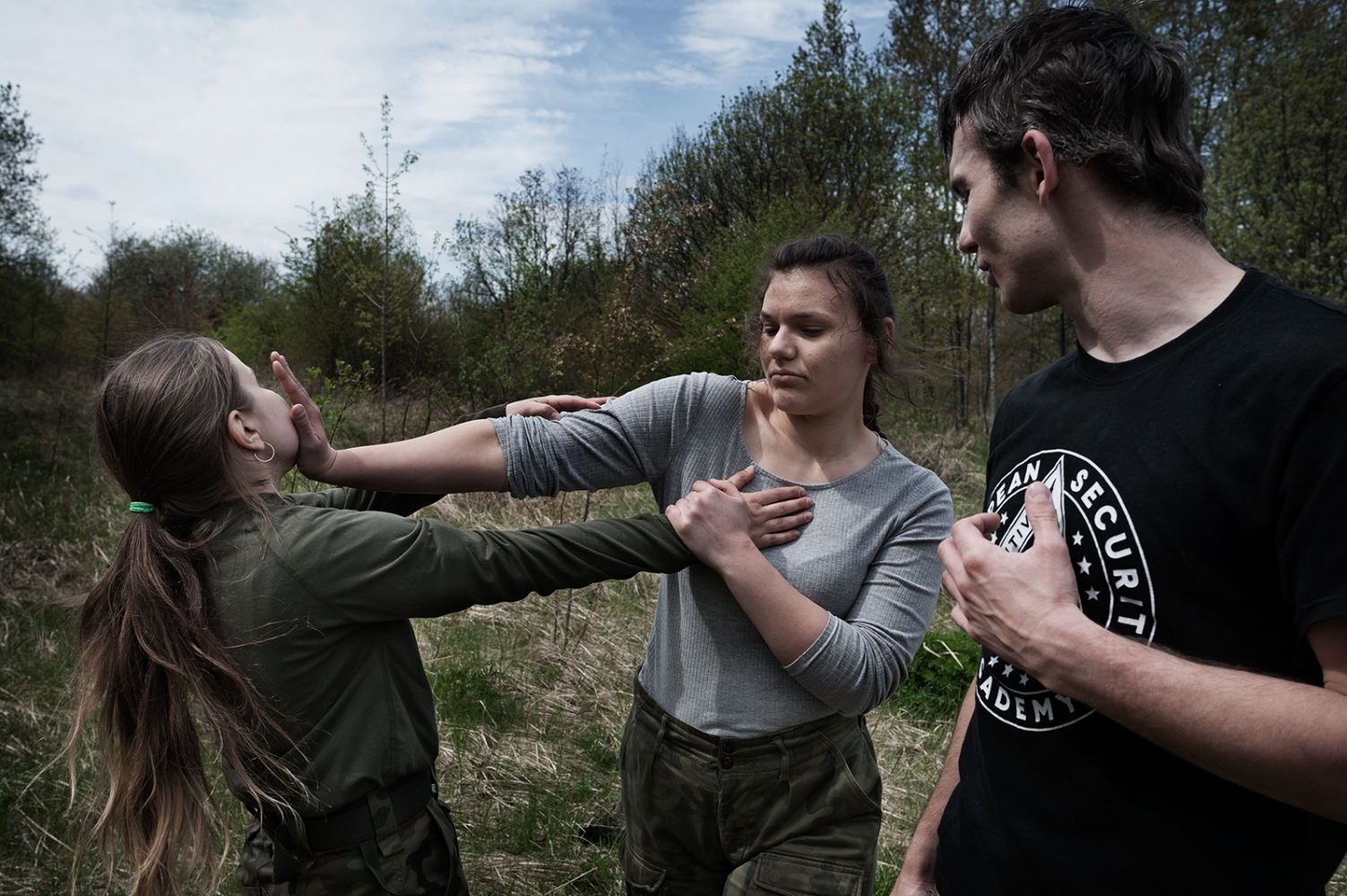 """Students of 16 and 17 years old, learning the Krav Maga movements with K.Z – an inspector from paramilitary organization.In general the paramilitary organizations are composed by soldiers or ex-soldiers, sometimes also by regular citizens who are passionate about military.K.Z. is an ex-soldier currently employed by a security firm similar to """"Blackwater""""."""
