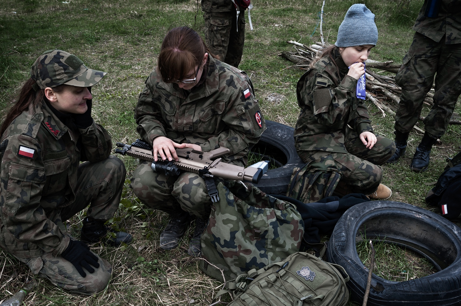 "Students between 16 and 19 years old rest after the practical activities carried out by a paramilitary organization within the frame of a ""Military Profile Classes"" program in the public high school in B. Currently, in Poland the number of students enrolled in this type of program is estimated at 57.000, but the Ministry of National Education does not have official data in this regard."