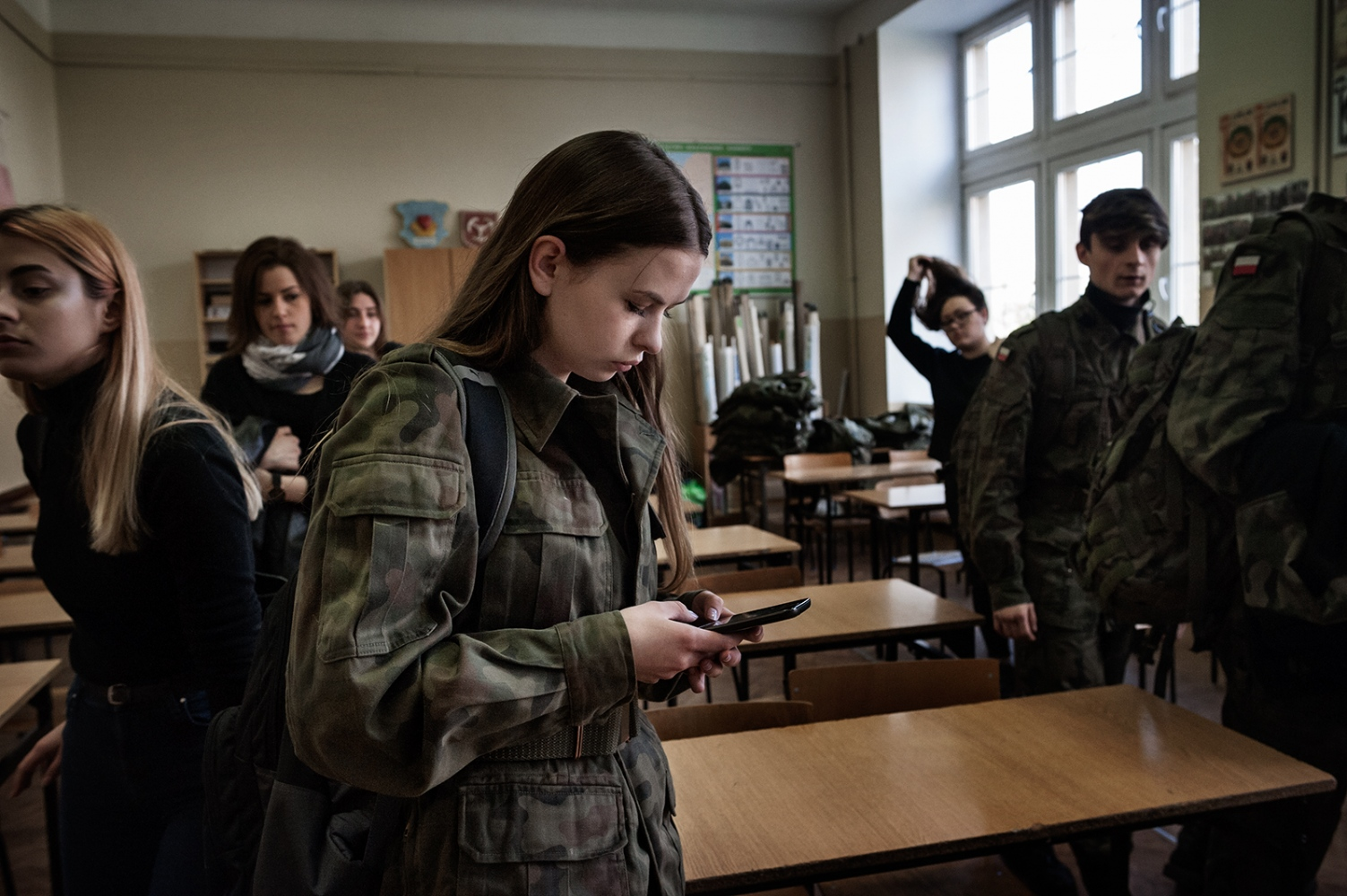 """One of the students (16 years old) of the """"Military Profile Classes"""" during the recreation (public high school in B.). In this school themilitary classes where created by M.B, professor of History and of the Education for security subject. M.B. was also one of the main promoters of paramilitary organization with which collaborates now the school."""
