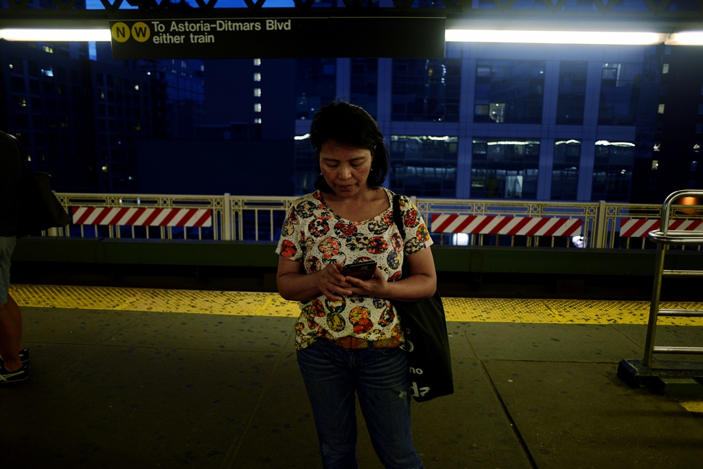 "Edith Mendoza, 51, catching the 7, nicknamed ""the train of immigrants"" by locals in Queens, NY."