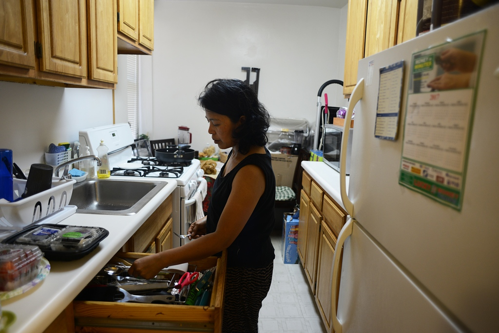 Edith Mendoza, 51, prepares dinner at the apartment she shares with three roommates in Queens, NY. I was not comfortable…always out of place. I would cook for them but feel hungry and shy. I remember what [Marieke] said to me when I ate some leftovers: 'You ask me first before you have to eat.' The worst was the two birds [that were] free to fly all over the house. I think I got sick from the birds. I ask [the Koehlers] to buy gloves, to buy masks. They never did. I bought them myself and they never reimbursed me. [Marieke] ignored me.