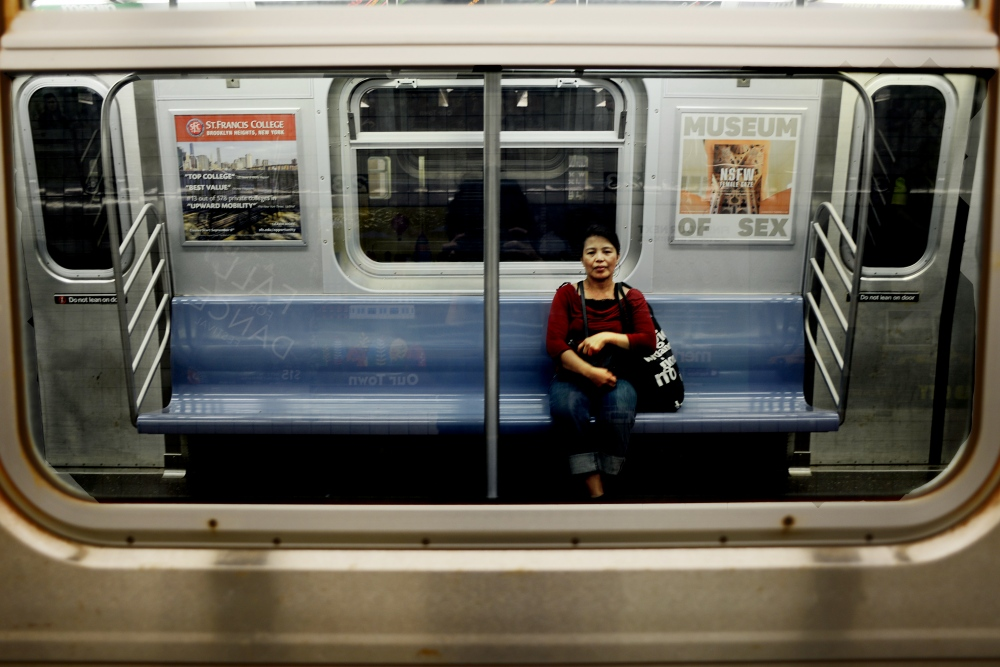 Edith Mendoza, 51, heads home on the E train after work in Queens, NY.
