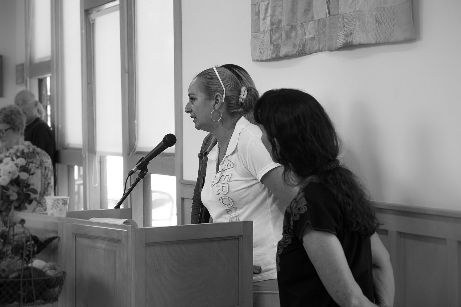 Aracel Fernandez speaks to a group of supporters while Dr. Ann Lopes looks on. Unitarian Universalist Fellowship Of Santa Cruz County, September 10th, 2017 Watsonville CA.